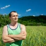 Farmer in the wheat field — Stock Photo #11538279