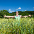 Stock Photo: Farmer in the wheat field