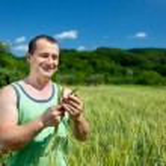 Farmer in the wheat field — Stock Photo #11538292