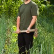 Gardener in onion field, weeding — Stockfoto #11540135