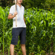 Stock Photo: Young farmer near corn field