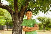 Happy kid in an orchard of apple trees — Stock Photo