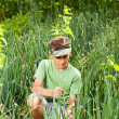 Boy in a lawn of onions — Stock Photo #11688739
