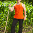 Photo: Young farmer near corn field