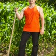 Stockfoto: Young farmer near corn field