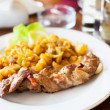 Foto Stock: Braided pork tenderloin with garnish