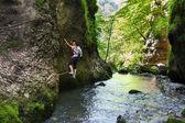 Woman climbing mountain wall — Stock Photo