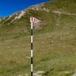 Hiking trail with route signs - Foto Stock