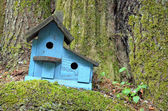 Blue wooden birdhouse — Stock Photo