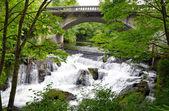 Bridge over waterfalls — Stock Photo