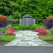 Lush spring garden entrance — Stock Photo