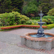 Garden water fountain in park - Stock Photo