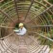 Worker assembling rebar — Stock Photo #11163251