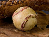 Worn baseball and old glove — Stock Photo