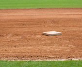 Base on baseball field — Stock Photo