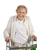 Happy old lady with walker — Stock Photo