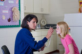 School nurse and patient — Stock Photo