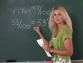 Math Teacher in classroom — Stock Photo
