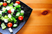 Natural Greek salad served on a plate — Stock Photo