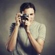 Portrait of young male photographer with a camera — Stock Photo #11267093
