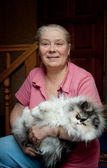 The elderly lady with a cat — Stock Photo