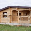 Wooden house under construction - Stock Photo