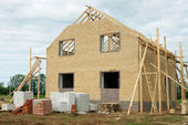 Brick house under construction — Stock Photo