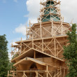 Stockfoto: Construction of rural wooden church. Russia