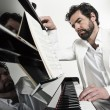 Man with piano — Stock Photo
