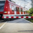 Train at the Railroad crossing — Stok fotoğraf