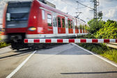 Train at the Railroad crossing — Stockfoto