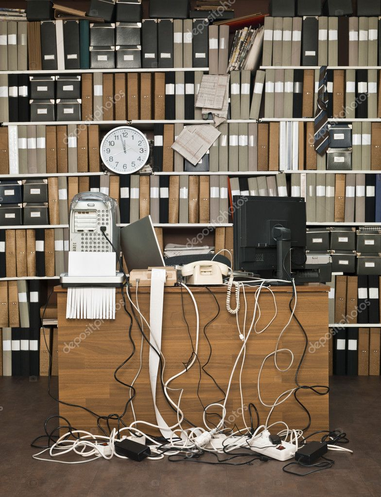 Overloaded desk at a messy office — Stock Photo #12288544