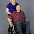 Senior couple with man in wheelchair — Stock Photo #11043572