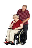 Senior couple with woman in wheelchair — Stock Photo