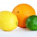 Beautiful wet citrus fruits over white — Stock Photo #11382097