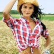 Pretty cowgirl in wheat field — Stock Photo