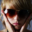 Blond girl with large sunglasses - Stock Photo
