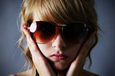 Blond girl with large sunglasses — Stock Photo