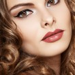 Beautiful face of young woman with clean skin, bright retro style make-up. Girl with long curly hairs. Bright lips make-up. Pin-up lovely model — Stock Photo
