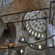 Inside the Blue mosque, Istanbul - Stock Photo
