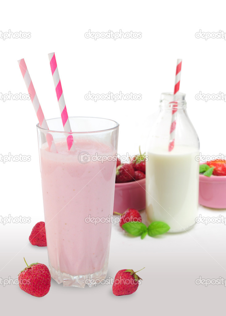 Strawberry smoothie in glass, bottle of milk and strawberries in the background — Stock Photo #11063864