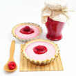 Two tarts and jar of raspberry jam - 