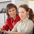 Mom and daughter with laptop — Stock Photo #11445688