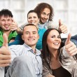 Thumbs up - happy young — Stock Photo