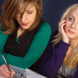 Two girls with their homework — Stock Photo