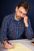 Researcher taking notes — Stock Photo
