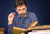 Researcher with the books — Stock Photo