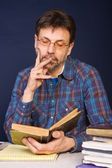 Researcher with his books — Stock Photo
