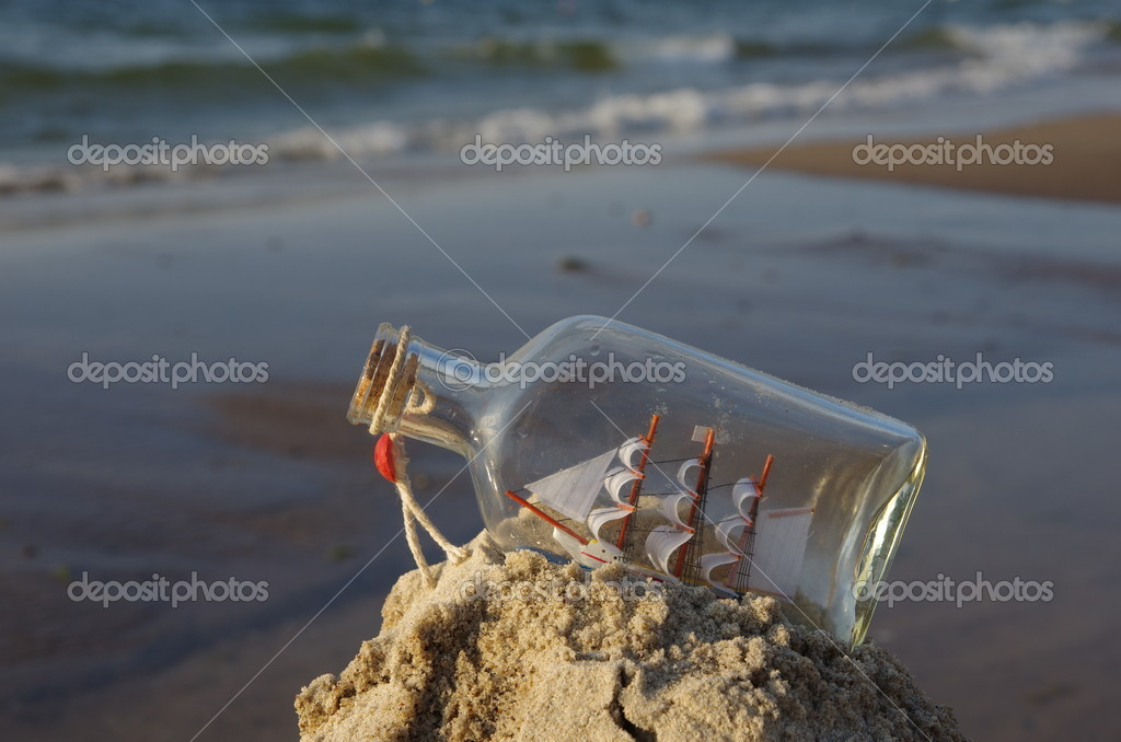 Sailcloth ship in closed with cork bottle  Stock Photo #11913575