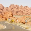 Truck on Curving Road Through Desert — Stock Photo